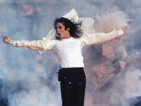 FILE - This Feb. 1, 1993 file photo shows Pop superstar Michael Jackson performing during the halftime show at the Super Bowl in Pasadena, Calif.  A musical about the King of Pop is moonwalking to Broadway. The Michael Jackson Estate and Columbia Live Stage are unveiling plans for a stage musical inspired by the life of Michael Jackson. They hope it will be ready for Broadway by 2020. (AP Photo/Rusty Kennedy, file) ORG XMIT: NYET200