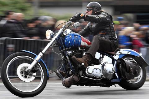 A biker rides his Harley-Davidson during a parade at the