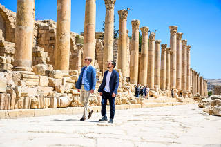 Britain's Prince William walk with Jordan's Crown Prince Hussein at the ancient city of Jerash
