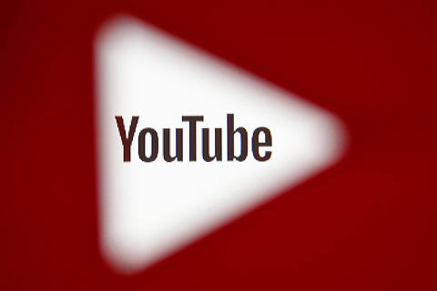 FILE PHOTO:    A 3D-printed YouTube icon is seen in front of a displayed YouTube logo in this illustration taken October 25, 2017. REUTERS/Dado Ruvic/Ilustration/File Photo ORG XMIT: TOR105