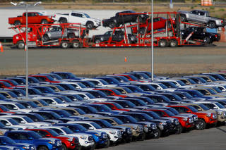 FILE PHOTO: Newly assembled vehicles are seen at a stockyard of the automobile plant Toyota Motor Manufacturing of Baja California in Tijuana