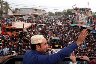 Bilawal Bhutto Zardari, chairman of the Pakistan People's Party, speaks to supporters from roof of bullet-proof bus, during campaign rally ahead of general elections
