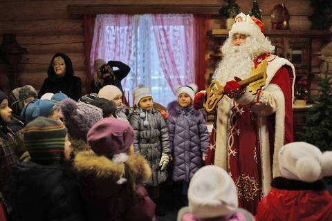 ORG XMIT: MOW001 - EDITORS NOTE -- CORRECTING DATE TO DECEMBER 11, 2012 -Ded Moroz (Grandfather Frost), the Russian Santa Claus, meets children to mark the upcoming New Year's holiday, at Ded Moroz' residence in Kuzminsky Park  in the south-east of Moscow, on December 18, 2012. New Year's is the biggest holiday of the year in Russia. AFP PHOTO / NATALIA KOLESNIKOVA