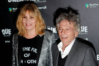 FILE PHOTO:French actor Emmanuelle Seigner and director Roman Polanski pose together prior to the screening of Polanski's movie