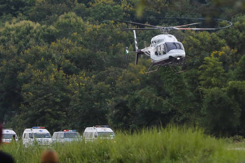A helicopter believed to be carrying one of the rescued boys from the flooded cave lands in Chiang Rai as divers continue to evacuate more of the boys and their coach trapped at Tham Luang cave in the Mae Sai district in Chiang Rai province, northern Thailand, Tuesday, July 10, 2018. (AP Photo/Vincent Thian) ORG XMIT: XVT111