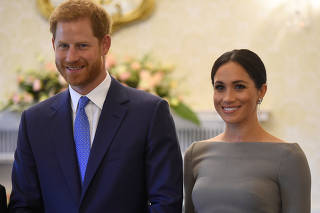 Britain's Prince Harry and his wife Meghan, Duchess of Sussex, smile as they prepare to meet Ireland's President, Michael Higgins, on their second day of a two-day visit to Dublin