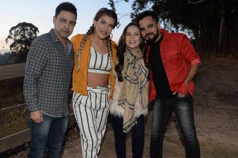 Zezé de Camargo e Luciano com Larissa Manoela e Lore Improta durante gravação de clipe