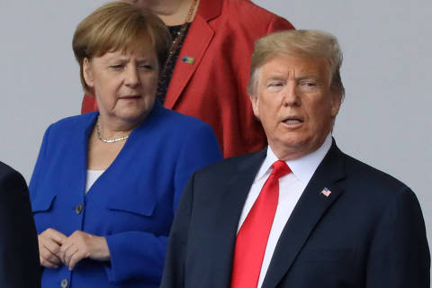 German Chancellor Angela Merkel and U.S. President Donald Trump are seen as they pose for a family photo at the start of the NATO summit in Brussels, Belgium July 11, 2018.   REUTERS/Reinhard Krause ORG XMIT: ZUZ125