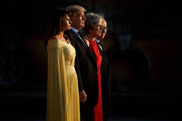 O presidente americano, Donald Trump, ao lado da mulher, Melania, da primeira-ministra britânica, Theresa May, e de de seu marido, Philip May,