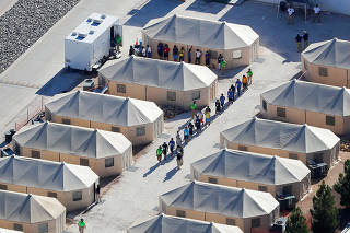 FILE PHOTO:    Immigrant children now housed in a tent encampment under the new