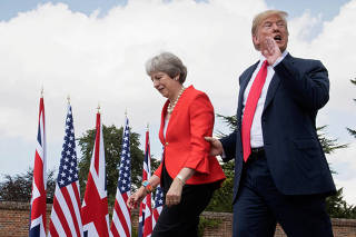 U.S. President Donald Trump walks with Britain's Prime Minister Theresa May prior to a joint press conference at Chequers, near Aylesbury