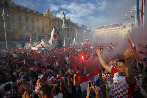 Croatia soccer fans shout chants and cheer as they watch a television broadcast of the Russia 2018 World Cup match between France and Croatia in downtown Zagreb, Croatia, Sunday, July 15, 2018. (AP Photo/Darko Vojinovic) ORG XMIT: XDMV109