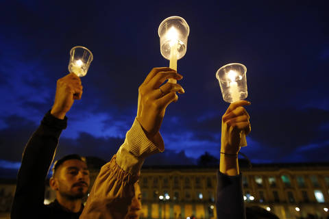 In this July 6, 2018 photo, demonstrators light candles during a candle light vigil for slain activists who have been killed since the signing of the peace accords in Bogota, Colombia. Thousands of people gathered at the Bolivar's square to attend a candle light for a mobilization for the life. (AP Photo/Fernando Vergara) ORG XMIT: XLAT307