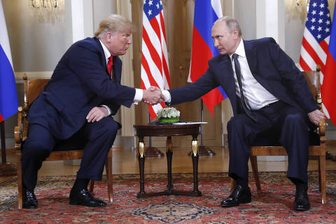 U.S. President Donald Trump, left, and Russian President Vladimir Putin shake hand at the beginning of a meeting at the Presidential Palace in Helsinki, Finland, Monday, July 16, 2018. (AP Photo/Pablo Martinez Monsivais) ORG XMIT: FOS226
