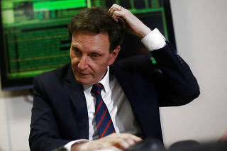 Rio de Janeiro's Mayor Crivella gestures during a meeting with Brazil's Finance Minister Meirelles in Brasilia