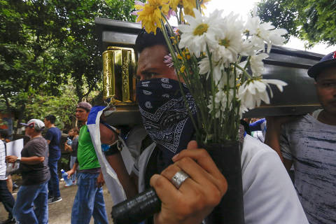 Friends and family carry the coffin with the body of Gerald Vasquez, an engineering student who was killed during the July 14 attack by police and paramilitary forces to the National University of Managua, to be buried in Managua, Nicaragua, Monday, July 16, 2018. The onslaught was televised by local media outlets and covered by three local journalists who reported via Facebook Live. Students fearing for their lives sent farewell messages to friends and family.