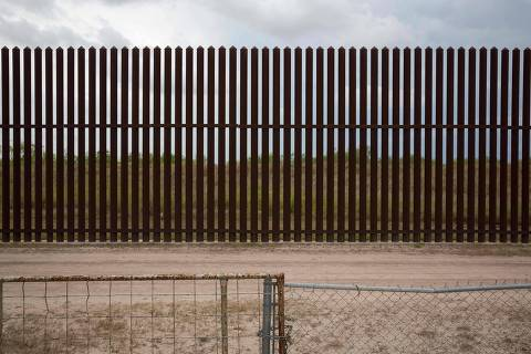 This photo shows a section of the US-Mexico border fence behind the home of Eloisa Tamez, an activist and opponent of the fence, on June 18, 2018 near San Benito, Texas. / AFP PHOTO / Loren ELLIOTT ORG XMIT: Border_16