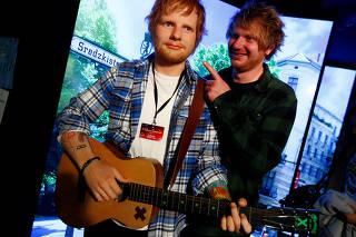 Nico Eckl, a lookalike of Ed Sheeran poses beside a wax figure of musician Ed Sheeran in the Madame Tussauds wax museum in Berlin