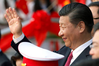 FILE PHOTO: China's President Xi Jinping waves after attending the inauguration ceremony of Chinese sponsored Vietnam-China Cultural Friendship Palace in Hanoi
