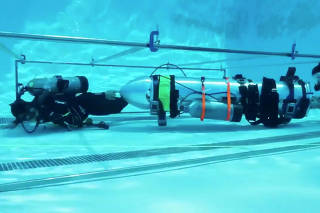 A device by Elon Musk's SpaceX and The Boring Company, designed to help rescue the remaining members of a soccer team trapped in a flooded cave in Chiang Rai, Thailand, is being tested in a swimming pool in Los Angeles