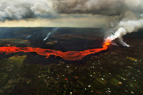 FILE - In this June 10, 2018 file photo, lava from the Kilauea volcano flows in and around Pahoa, Hawaii. (AP Photo/L.E. Baskow, File) ORG XMIT: CAJC601