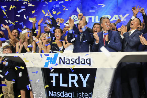 Brendan Kennedy, third from right in front, CEO and founder of British Columbia-based Tilray Inc., a major Canadian marijuana grower, leads cheers as confetti falls to celebrate his company's IPO (TLRY) at Nasdaq, Thursday, July 19, 2018, in New York. Medical marijuana is legal in Canada, and on Oct. 17, the country will become the first major industrialized nation to legalize its production and sale for recreational use. (AP Photo/Bebeto Matthews) ORG XMIT: NYBM102