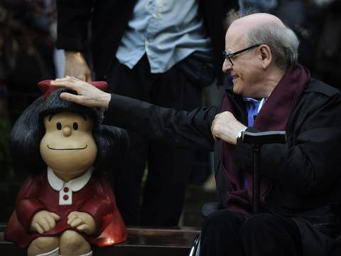 Cartoonist Joaquin Salvador Lavado, also known as Quino, touches a sculpture of his comic character Mafalda, during an opening ceremony of a park of San Francisco in Oviedo, northern Spain, October 23, 2014. Quino will be awarded with the 2014 Prince of Asturias Award for Communication and Humanities at a ceremony on Friday in the Asturian capital. The Prince of Asturias Awards have been held annually since 1981 to reward scientific, technical, cultural, social and humanitarian work done by individuals, teams and institutions. REUTERS/Eloy Alonso (SPAIN - Tags: SOCIETY MEDIA ENTERTAINMENT) ORG XMIT: EAG01
