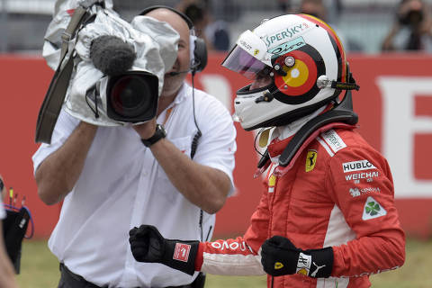 Ferrari driver Sebastian Vettel of Germany celebrates after setting a pole position during the qualifying session at the Hockenheimring racetrack in Hockenheim, Germany, Saturday, July 21, 2018. The German Formula One Grand Prix will be held on Sunday, July 22, 2018. (AP Photo/Jens Meyer) ORG XMIT: XDMV169