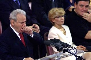 File photo shows former Yugoslav President Milosevic coughing in Belgrade