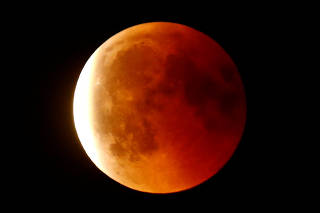 The full moon is seen during a lunar eclipse in the sky over Frankfurt