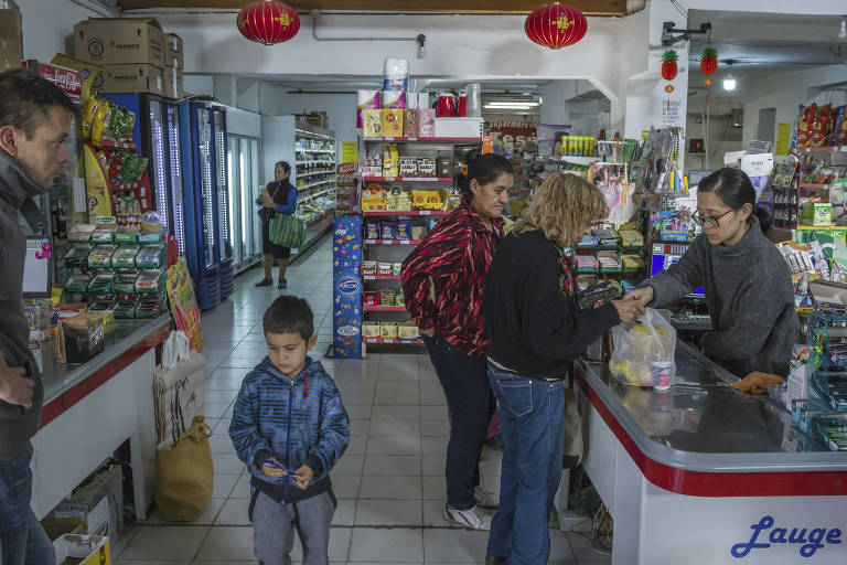 Lily Huang, right, from China, works at the Argen-Chino supermarket in the town of Las Lajas, Argentina, about 37 miles south of the Chinese space station, April 27, 2018. The isolated station is one of the most striking symbols of Beijing?s long push to transform Latin America and shape its future for generations to come. (Mauricio Lima/The New York Times)