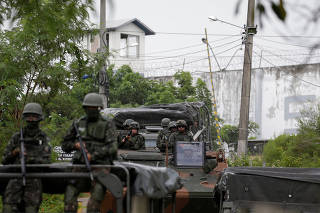 Armed Forces members leave the Milton Dias Moreira penitentiary after an inspection operation in Japeri, near Rio de Janeiro
