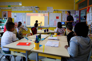 School children work in their classroom at the Primary School Les Ormeaux in Montereau-Fault-Yonne near Paris