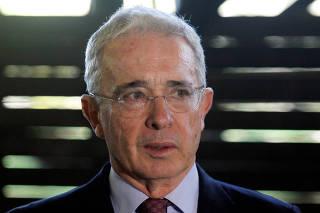 Former Colombian President Alvaro Uribe talks to the media in Rionegro