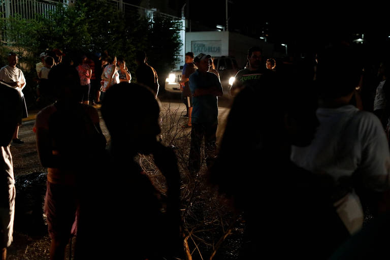 People block a street in protest during a blackout in Maracaibo
