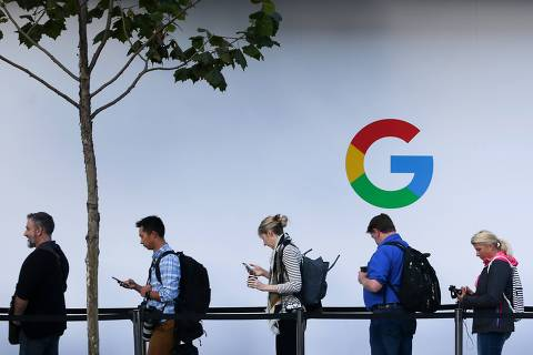 (FILES) In this file photo taken on October 4, 2017, people wait to enter a Google product launch event on at the SFJAZZ Center in San Francisco, California. US President Donald Trump lashed out on July 19, 2018, after Brussels hit US tech giant Google with a record fine, and warned he would no longer allow Europe to take