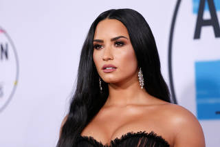 FILE PHOTO: Singer and actress Demi Lovato arrives at the 2017 American Music Awards in Los Angeles