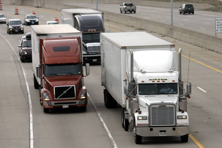 Two freight trucks are driven on the Fisher freeway in Detroit, Michigan