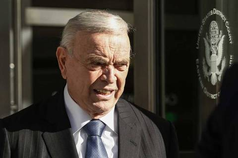 Former Brazilian Football Confederation president Jose Maria Marin (C) leaves Federal District Court in Brooklyn, on December 16, 2015, in New York. Marin has pleaded not guilty in connection with the massive FIFA corruption scandal and has agreed to a $15 million bond.   AFP PHOTO/KENA BETANCUR ORG XMIT: KB09