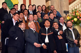 Bolivia's President Evo Morales takes a selfie with members of his cabinet at the old presidential palace in La Paz