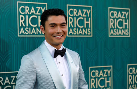 Cast member Henry Golding poses at the premiere for
