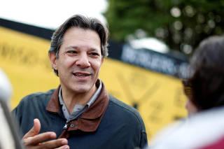 Former Sao Paulo mayor Haddad leaves the Federal Police headquarters, where Brazilian former President Lula da Silva is imprisoned, in Curitiba