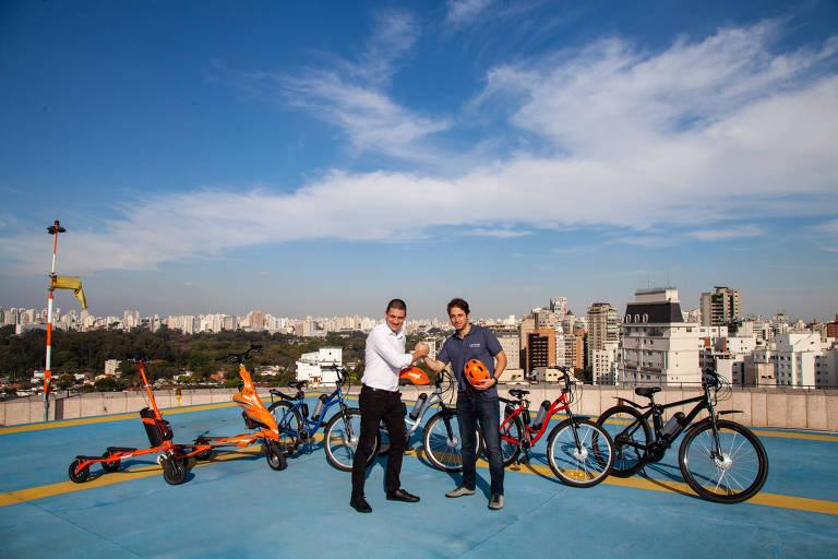 Empresários de locação de bikes dão as mãos em topo de prédio de São Paulo