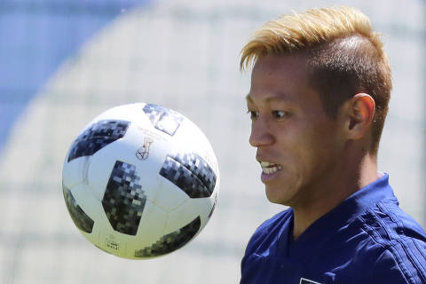 FILE - In this June 17, 2018, file photo, Japan's Keisuke Honda warms up during a training session of the Japan national soccer team at the 2018 soccer World Cup in Kazan, Russia. Melbourne Victory confirmed on Monday, Aug. 6, 2018, the signing of Honda for the 2018-2019 Australian A-League season. (AP Photo/Eugene Hoshiko, File) ORG XMIT: SYD101