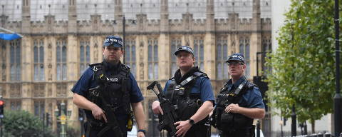 Armed police on Victoria Embankment in Westminster, after a car crashed into security barriers outside the Houses of Parliament, in London, Tuesday, Aug. 14, 2018. London police say that a car has crashed into barriers outside the Houses of Parliament and that there are a number of injured. (Stefan Rousseau/PA via AP) ORG XMIT: AMB805