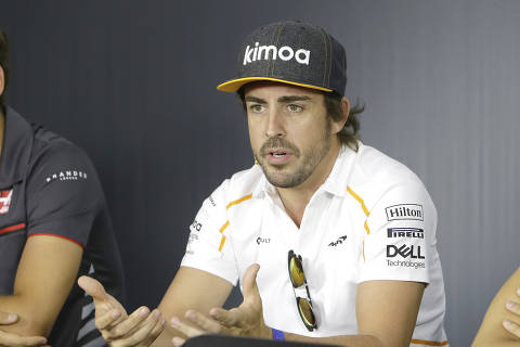 McLaren driver Fernando Alonso of Spain speaks during a news conference at the Paul Ricard racetrack, in Le Castellet, southern France, Thursday, June 21, 2018. The Formula one race will be held on Sunday. (AP Photo/Claude Paris) ORG XMIT: CAS113
