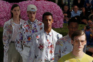 Models present creations by designer Kim Jones for Dior Homme collection as part of their Spring/Summer 2019 collection show during Men's Fashion Week in Paris