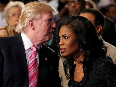 FILE PHOTO: Republican presidential nominee Donald Trump and Omarosa Manigault attend a church service, in Detroit, Michigan, U.S., September 3 2016.   REUTERS/Carlo Allegri/File Photo ORG XMIT: TOR260