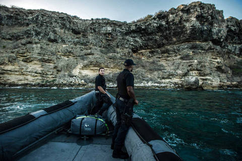 Members of the Dutch Caribbean Coast Guard patrol Caracas Bay, looking for smugglers and Venezuelan migrants, off the coast of Willemstad, on the caribbean island of Curacao, Oct. 24, 2016. Well over 150,000 people have fled the economic collapse in Venezuela in the last year alone, the most in more than a decade, scholars say, with the sea route posing special dangers. (Meridith Kohut/The New York Times)
