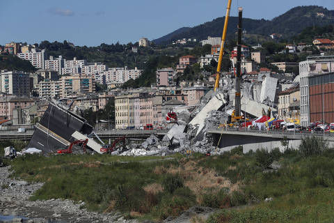 Rescuers work among the rubble of the Morandi highway bridge that collapsed in Genoa, northern Italy, Wednesday, Aug. 15, 2018. A large section of the bridge collapsed over an industrial area in the Italian city of Genova during a sudden and violent storm, leaving vehicles crushed in rubble below. (AP Photo/Antonio Calanni) ORG XMIT: GEO125